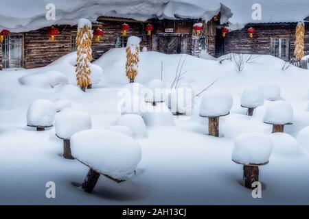 Snow mushrooms and buildings in snow-covered landscape of China's snow town in Harbin - Stock Photo