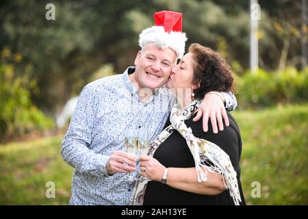 Swansea, Wales, UK. 23rd Dec 2019. Monday 23rd December 2019 Swansea, UK. Pictured are Stephen and Lesley Schiltz from Pontardawe near Swansea, who have won a guaranteed million pounds on The National Lottery EutoMillions UK Millionaire Maker. The couple, who moved to South Wales from London under a year ago, plan to spend some of the winnings on a holiday to Australia. Credit: Robert Melen/Alamy Live News Stock Photo