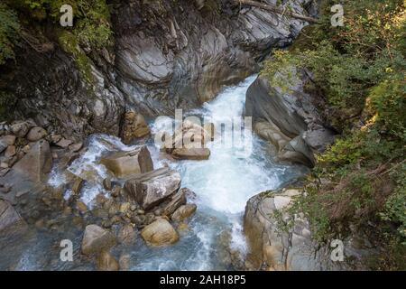 Alpine torrent near Sulzbach fall, gorge and rocks. Geology of Untersulzbach valley. Venediger group. Hohe Tauern National Park. Austrian Alps. - Stock Photo