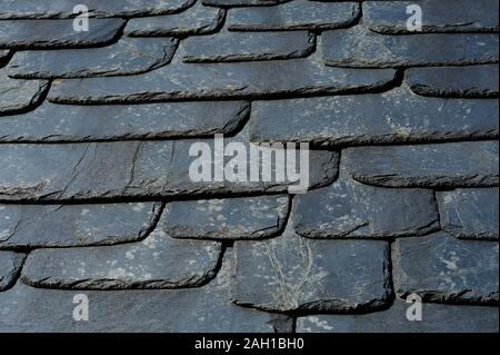 Rustic black slate roof texture. - Stock Photo