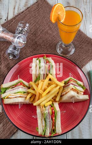 American Foods - Classic Club Sandwich with French Fries.  Club sandwich restaurant concept. - Stock Photo
