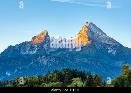 The first sunlight hits the famous Mount Watzmann in the Bavarian Alps - Stock Photo