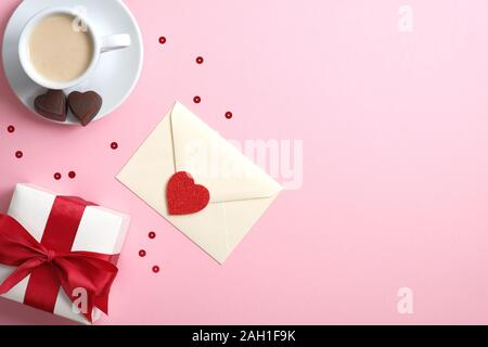 Happy Valentine's Day concept. Flatlay composition with gift box, romantic love letter, Valentine heart and coffee cup. Flat lay, top view, copy space - Stock Photo
