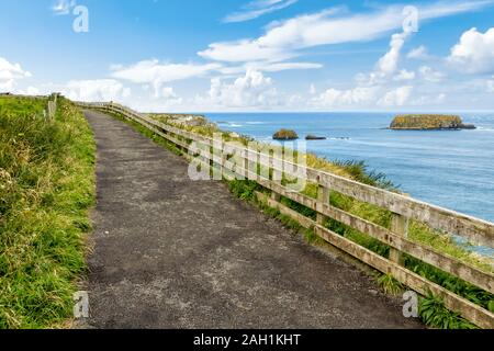 Cliffs of Carrick-a-rede rope bridge in Ballintoy, Co. Antrim. Landscape of Northern Ireland.Traveling through the Causeway Coastal Route. - Stock Photo