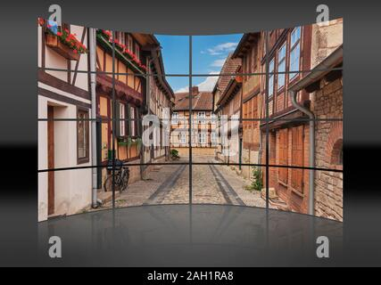 A curved wall. 16 small pictures give a whole picture. Gildschaft alley in Quedlinburg, Saxony-Anhalt, Germany, Europe - Stock Photo