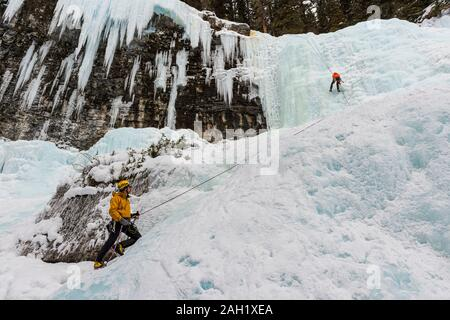 Ice climbers at Johnston Creek, Banff National Park, Alberta, Canada, - Stock Photo