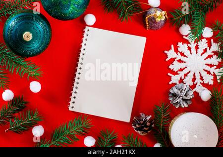 Top view Flat lay Christmas still life from christmas decorations on a red background