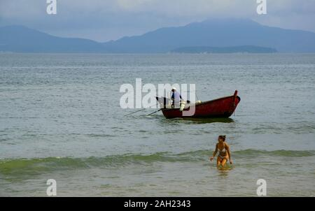 Fishing and bathing in Hoi An, Vietnam - Stock Photo