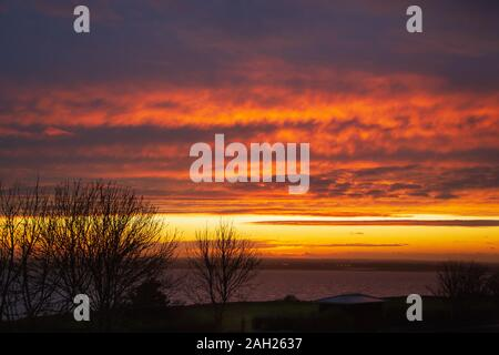 Dramatic sky and cloudscape just after sunset over Pegwell Bay in Ramsgate, Kent, UK. - Stock Photo