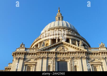 View of the iconic London landmark, historic St Paul's Cathedral with its dome designed by Sir Christopher Wren, on a sunny autumn day - Stock Photo