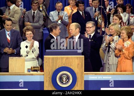 President Gerald Ford, as the Republican nominee, shakes hands with nomination foe Ronald Reagan on the closing night of the 1976 Republican National Convention. Vice-Presidential Candidate Bob Dole is on the far left, then Nancy Reagan, Governor Ronald Reagan is at the center shaking hands with President Gerald Ford, Vice-President Nelson Rockefeller is just to the right of Ford, followed by Susan Ford and First Lady Betty Ford. August 19, 1976