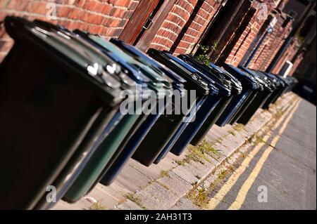 Row of dustbins waiting to be emptied, Jesmond, Tyne and Wear - Stock Photo