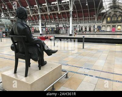 A statue of Isambard Kingdom Brunel looks out over London's Paddington Station which is empty of trains on Christmas Eve because of major engineering work over the holiday period on the railway line between Paddington and Slough. - Stock Photo