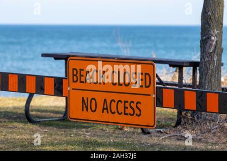 Burlington, Canada, December 23 2019: Sign indicating Lake Ontario beach at Burlington Waterfront is closed Stock Photo