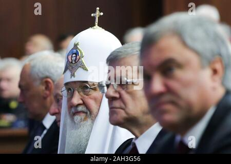 Moscow, Russia. 24th Dec, 2019. MOSCOW, RUSSIA - DECEMBER 24, 2019: Patriarch Kirill of Moscow and all Russia and Russian Prosecutor General Yuri Chaika (L-R center) at a meeting of the Russian Defense Ministry Board to sum up the results of the Armed Forces' activity in 2019 and outline objectives for 2020, at the National Defense Control Center. Mikhail Metzel/TASS Credit: ITAR-TASS News Agency/Alamy Live News - Stock Photo