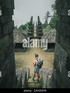Back view of man standing at Cetho Temple, Karanganyar, Central Java, Indonesia - Stock Photo
