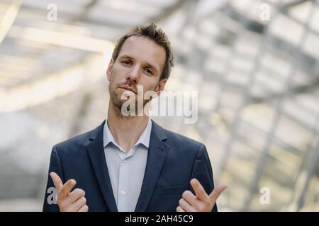 Portait of self-confident businessman - Stock Photo