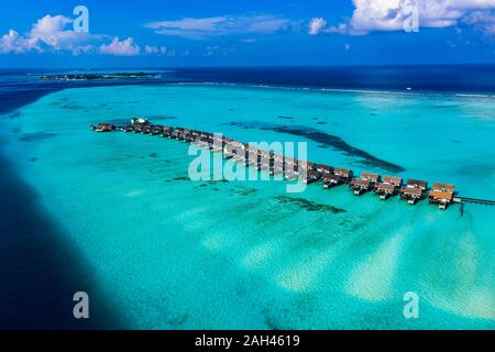 Maldives, South Male Atoll, Kaafu Atoll, Aerial view of Bungalows on sea