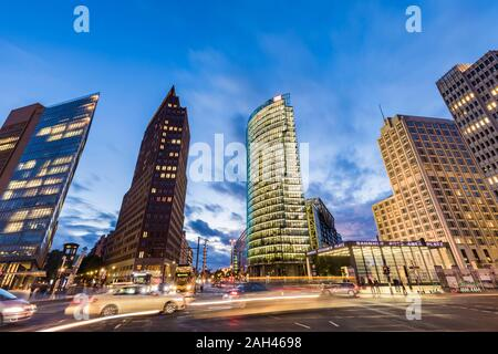 Germany, Berlin, Mitte, Potsdamer Platz, Kollhoff-Tower, Bahntower, Beisheim-Center, Traffic on street - Stock Photo