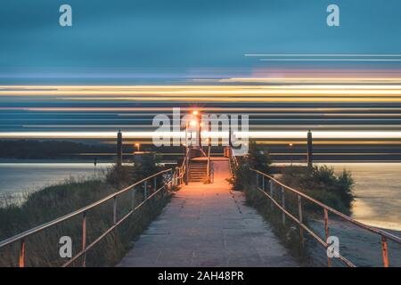 Germany, Hamburg, Rissen, Blurred cruise ship on river Elbe - Stock Photo