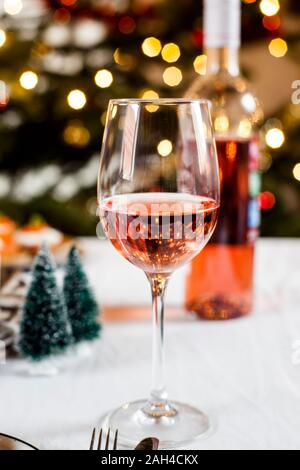 Glass of blushed wine in front of Christmas decoration
