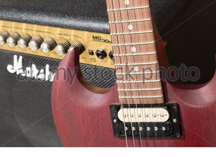 A Gibson SGJ guitar with a Marshall amplifier - Stock Photo