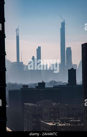 Billionaire's Row, a collection of super-tall residences for the uber-rich mostly on West 57th Street is seen from Harlm in New York on Sunday, December 22, 2019. (© Richard B. Levine) - Stock Photo
