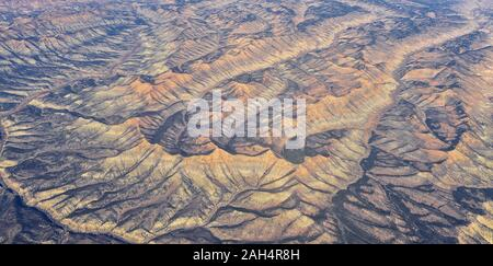 Colorado Rocky Mountains Aerial panoramic views from airplane of abstract Landscapes, peaks, canyons and rural cities in southwest Colorado and Utah. - Stock Photo
