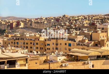 Large-scale dish blight in a residential neighborhood of Fez, Morocco, where hundreds of personal satellite dishes sit on rooftops. - Stock Photo