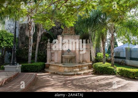 La Princesa Garden in Old San Juan. Small Park with a fountain, a walking path, playgrounds for children and some statues.This is one of the entrances. - Stock Photo