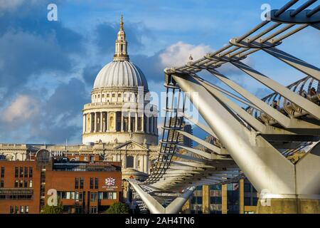 Millennium Bridge over the River Thames with a view of the iconic dome of St Paul's Cathedral and the City of London School, London EC4