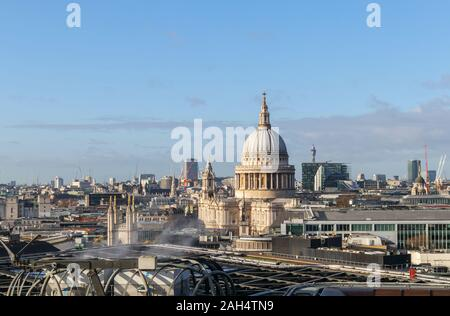 Rooftop view of the iconic dome of St Paul's Cathedral by Sir Christopher Wren on London's skyline, looking west from the City of London, UK