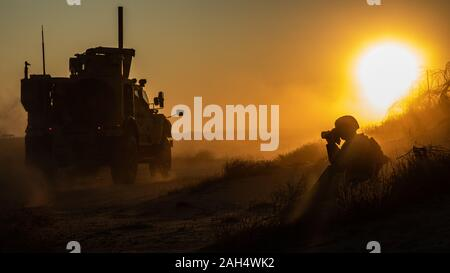A U.S. Marine assigned to the Special Purpose Marine Air-Ground Task Force – Crisis Response – Central Command (SPMAGTF-CR-CC) 19.2, photographs a Mine Resistant Ambush Protected All-Terrain Vehicle (M-ATV) during a tactical vehicle driving course in Kuwait, Dec. 21, 2019. The SPMAGTF-CR-CC is a quick reaction force, prepared to deploy a variety of capabilities across the region. (U.S. Marine Corps photo by Sgt. Kyle C. Talbot