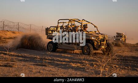 U.S. Marines with 2nd Battalion, 7th Marines, assigned to the Special Purpose Marine Air-Ground Task Force – Crisis Response – Central Command (SPMAGTF-CR-CC) 19.2, drive a Utility Task Vehicle (UTV) during a tactical vehicle driving course in Kuwait, Dec. 21, 2019. The SPMAGTF-CR-CC is a quick reaction force, prepared to deploy a variety of capabilities across the region. (U.S. Marine Corps photo by Sgt. Kyle C. Talbot) - Stock Photo