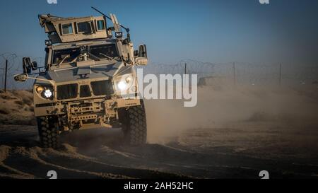 A U.S. Marine with 2nd Battalion, 7th Marines, assigned to the Special Purpose Marine Air-Ground Task Force – Crisis Response – Central Command (SPMAGTF-CR-CC) 19.2, drive a Mine Resistant Ambush Protected All-Terrain Vehicle (M-ATV) during a tactical vehicle driving course in Kuwait, Dec. 21, 2019. The SPMAGTF-CR-CC is a quick reaction force, prepared to deploy a variety of capabilities across the region. (U.S. Marine Corps photo by Sgt. Branden J. Bourque)