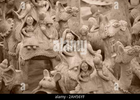 Human and animal figurines made of clay. - Stock Photo