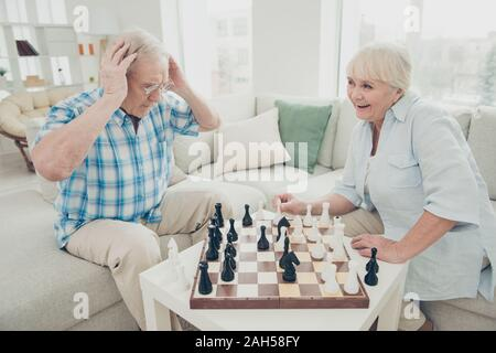 Portrait of his he her she two nice attractive cheerful cheery positive, intelligent people creating move pieces win winner amateur championship in li - Stock Photo