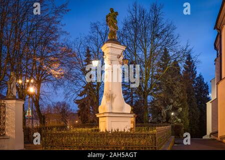 Saint Anthony of Padua statue in front of bernardine church, Piotrkow Trybunalski, Poland - Stock Photo