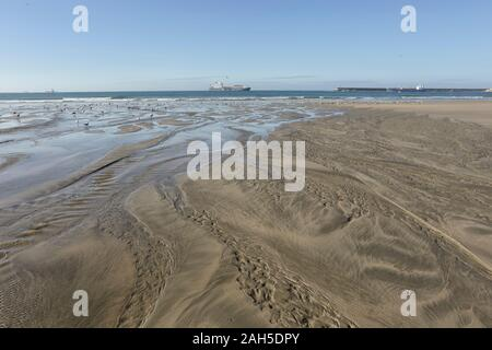 Empty beach during low tide. Matosinhos beach seeing Leixoes harbor entry. - Stock Photo