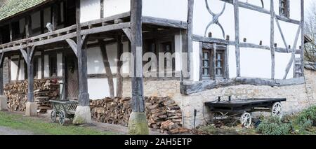 Ungersheim, Haut-Rhin / France - 13. December, 2019: view of a historic Alsatian half-timbered farmhouse - Stock Photo