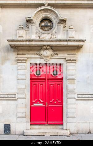 Paris, beautiful wooden door, typical building in the Marais, with carved lintel - Stock Photo