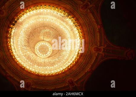 vintage ornate large chandelier in the Opera. the ceiling architecture - Stock Photo