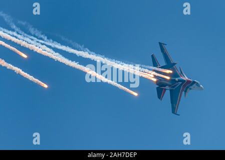Sukhoi Su-30 jet fighter jets of the Russian Knights aerobatics team performing formation flight during MAKS 2019 airshow, Zhukovsky, Russia. - Stock Photo