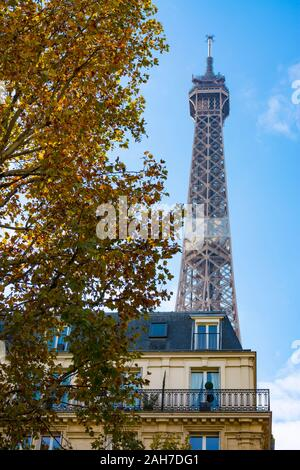 Paris, France - November 8, 2019: The Eiffel tower from Bourdonnais avenue. Long tree-lined avenue, full of neoclassical buildings, parallel to the Fi - Stock Photo