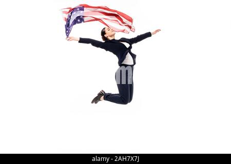 young businesswoman jumping in dance while holding usa national flag isolated on white - Stock Photo