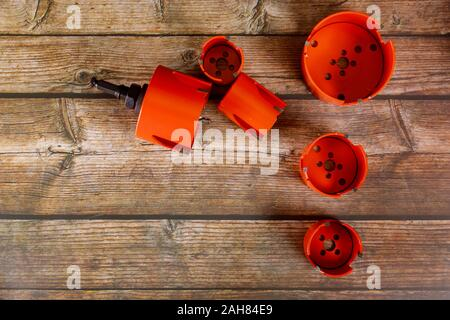 Hole making tools a bunch of drill bits on drill core drill for wood - Stock Photo