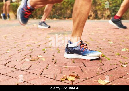 legs of runners a day's race in a park. sport concept. - Stock Photo