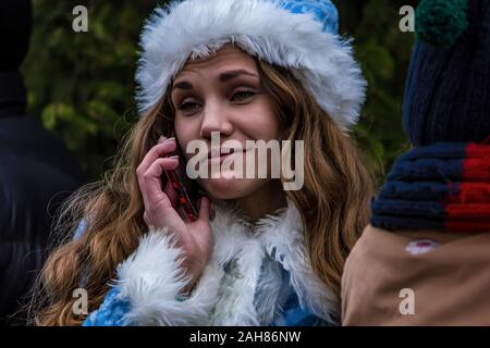 Woman in a fabulous costume calls on the phone with an interesting expression - Stock Photo