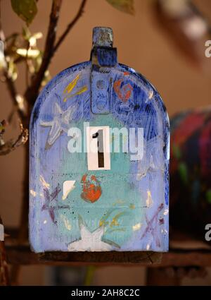 Mailboxes decorated by artists in front of art galleries on Canyon Road in Santa Fe, New Mexico. The historic road is noted for its many art galleries. - Stock Photo