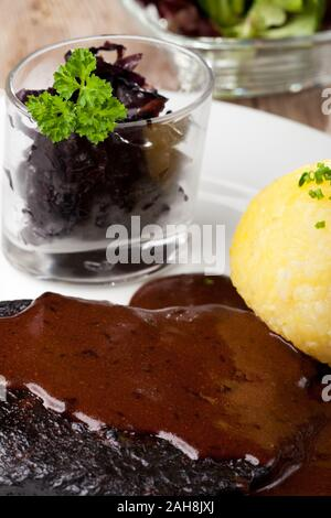 sauerbraten meat and potato dumpling - Stock Photo